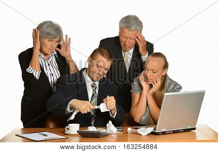 Portrait of business people at office tear papers