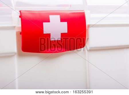 White Case with red clasp and a white cross