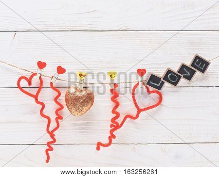 Golden Heart Hanging On Clothesline