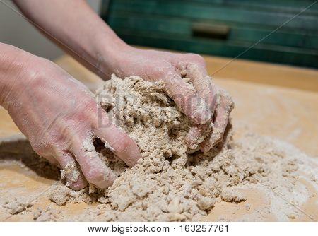 Hands Kneading Cake Dough