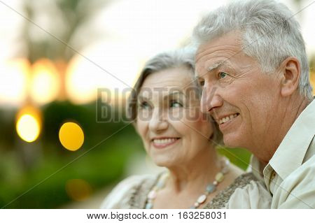 mature couple in love, travel, enjoy summer, posing outdoors