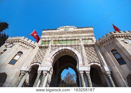 The arched monumental moorish styled gate of Istanbul University on Beyazit Square Istanbul Turkey
