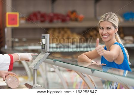 Beautiful Woman Showing Thumbs Up In Supermarket
