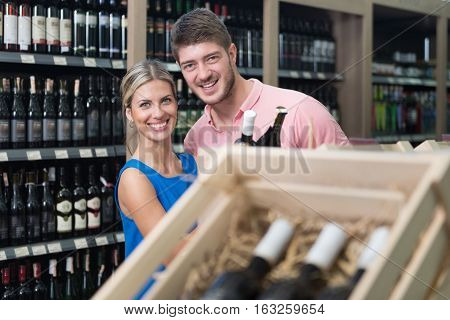 Couple At Groceries Store Buy Wine