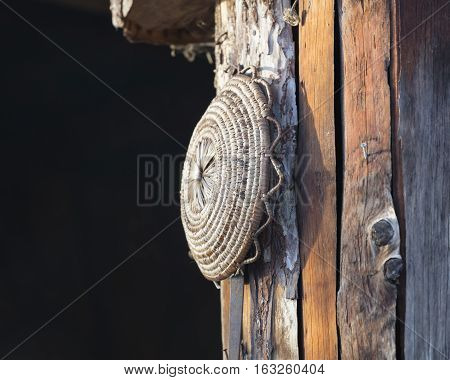 old tool hanging on the ancient hut