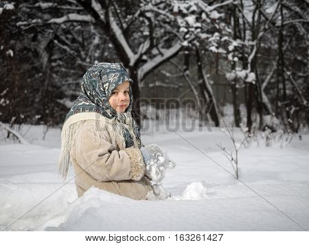 Little girl with snow mittens. Winter cold large drifts