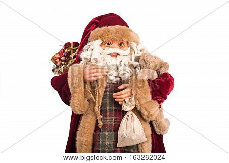 Portrait Of A Santa Claus Posing With Full Bag Of Gifts Isolated On White Background