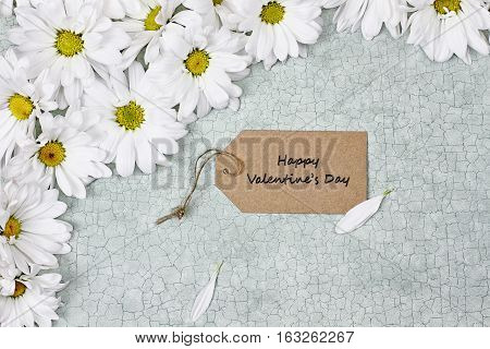 Valentines card and daisies over green craquelure background with room for your text.