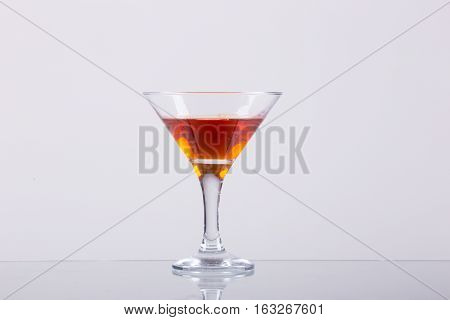 Cold alcoholic cocktail on the white background