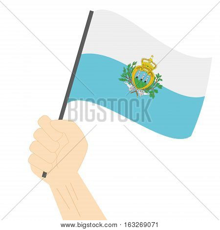 Hand holding and raising the national flag of San Marino