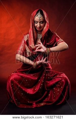 Portrait of beautiful indian girl . Young hindu woman model kundan jewelry . Traditional costume.