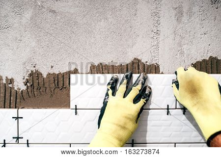 Industrial Worker Installing Ceramic Tiles.shower Area Covered In Ceramic Tiles With Strong Adhesive