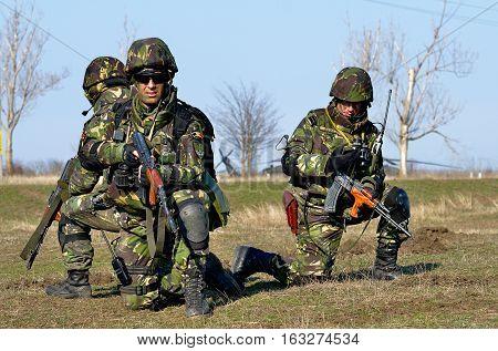 GALATI ROMANIA - MARTH 24: Romanian infantry in military polygon in the exercise Smardan Saber Junction 15 on Galati Romania 24 march 2014.