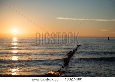 Breakwaters In The Baltic Sea Over The Sunset
