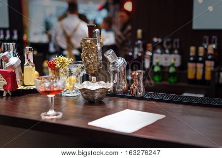 Set of bar accessories and ingredients for making a cocktails on counter