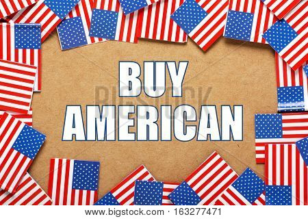 The words Buy American surrounded by flags of the United States of America as a reminder to buy their products and services