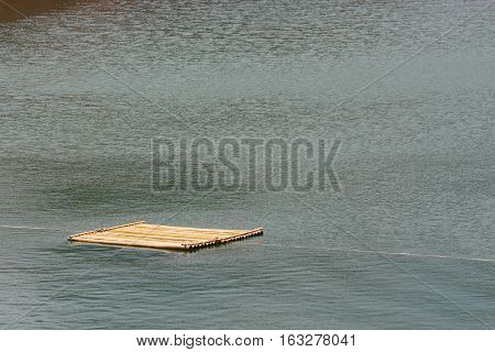 Bamboo Raft Floating On Water
