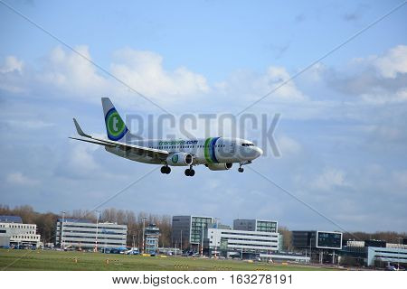 Amsterdam The Netherlands april 11 2015: PH-XRV Transavia Boeing 737-7K2(WL) approaching runway 09-27 Buitenveldert