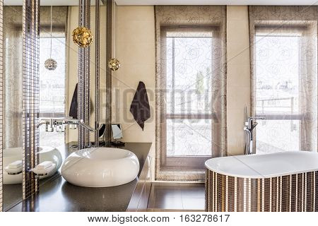 Luxurious bathroom interior with comfortable bathtub and sink