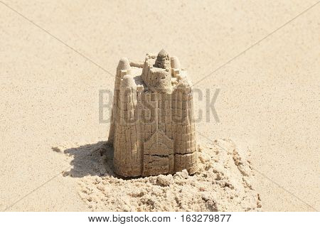 Detailed photograph of a sandcastle on the sunny day