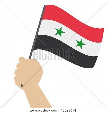Hand holding and raising the national flag of Syria