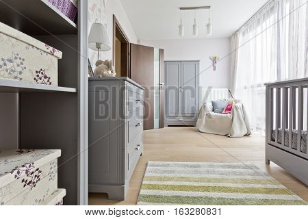Grey Room With Baby Cot