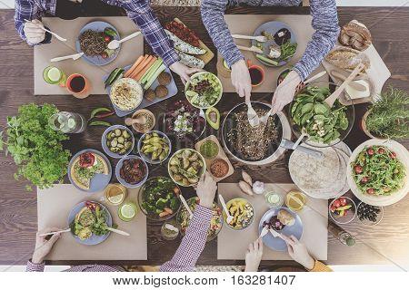 Enjoying Family Dinner At Restaurant