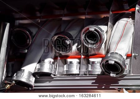 Detail with heavy duty water hoses on firefighter vehicle