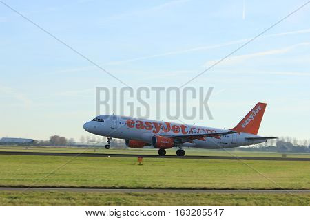 Amsterdam the Netherlands - November 25th 2016: G-EZWB Easy Jet Airbus A320-214 taking off from Polderbaan Runway at Amsterdam Airport Schiphol