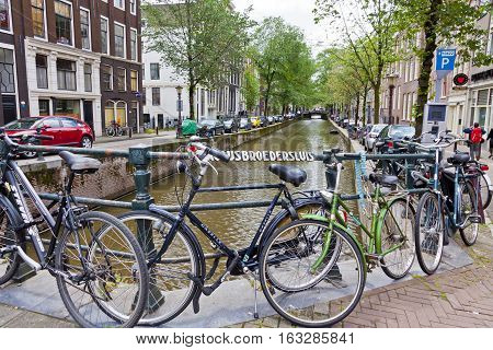 Bicycles Parked On Paulusbroedersluis Bridge In Amsterdam