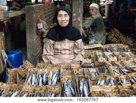 Indonesian woman selling dried fish at the market. January 17 2014 - Surabaya Java Indonesia
