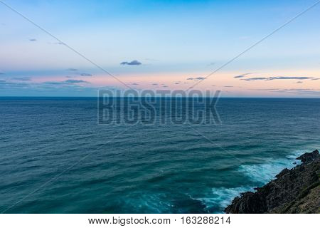 Views of the Pacific Ocean from Cape Byron in Australia at sunset