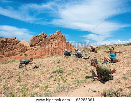 A Group Of Yogis In An Exotic Fairy Tale Canyon, Kyrgyzstan.