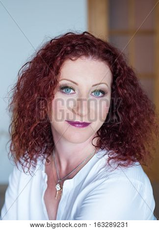 Pretty red-haired girl close-up with professional makeup