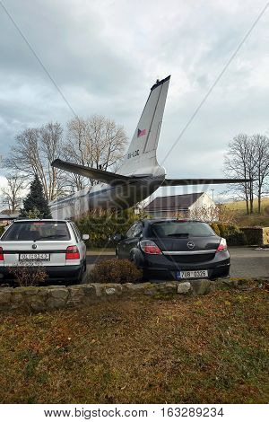 Petrovice Ustecky kraj Czech republic - december 10 2016: black car Opel Astra parked near the airliner Tupolev T-104 as a restaurant