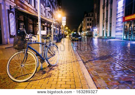 Riga, Latvia - July 4, 2016: Single Bicycle Bike Parking On Kungu Street In Old Part European Town In Summer Evening Night.