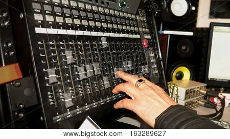 sound music mixer control panel controlling hand