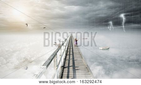 Bird flying on fantasy opposite weather sky beautiful sun ominous stormy sky clouds and bridge infinity conception for composite