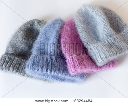 Four Caps Of Different Colors Connected By Hand From Mohair