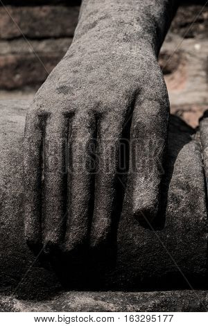 The old statue hand of buddha image
