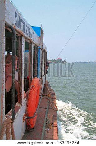 People Are Riding In Ferry By Sea