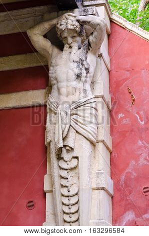 Catania, Italy - September 13, 2015: Atlant statue under bridge in Catania, Italy