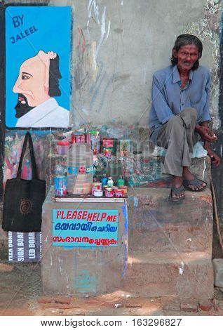 Poor Man Is Selling His Pictures Outdoor In Kochi, India
