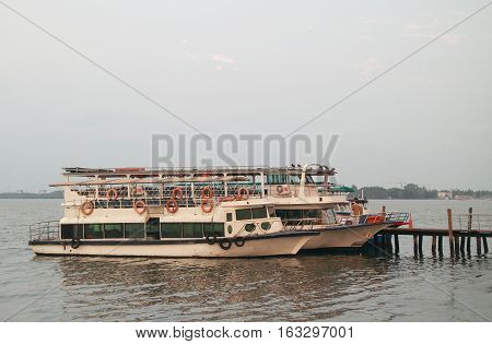 a few ferries in sea port of Kochi India