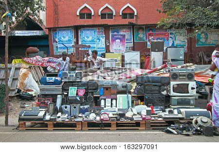 Man Is Selling Old Phones And Tape Recorders Outdoor