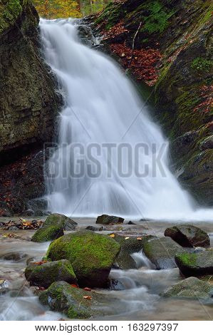 Fall landscape with huge water falling detail. Colossal cascade waterfall in Slovakia.