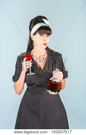 Sultry Retro Woman In Black Dress With Cosmopolitan