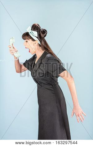 Yelling Retro Woman In Black Dress With Phone Receiver