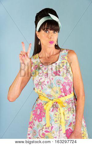 Cute Woman Holding Up V Symbol