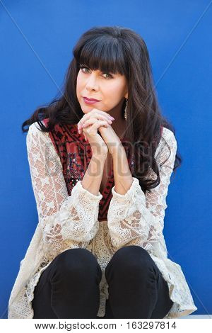 Pretty Woman In Front Of Blue Wall